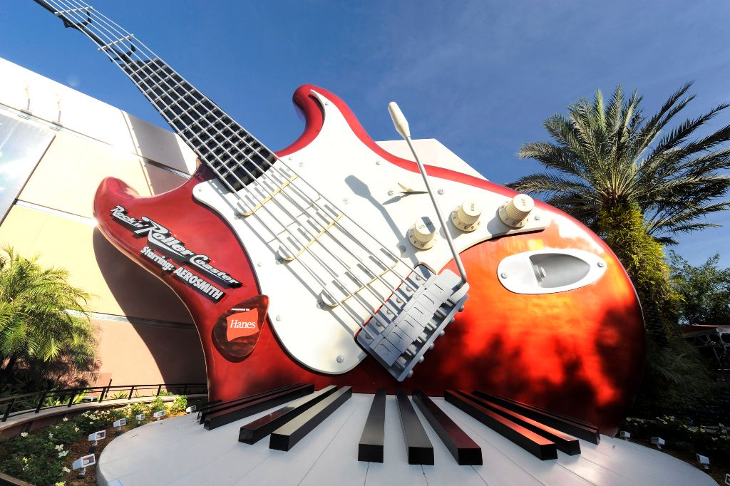 "ROCK ON!:  A 40-foot-tall electric guitar and giant keyboard adorn the exterior of the ""Rock 'n' Roller Coaster Starring Aerosmith.""  The thrill attraction is an indoor roller coaster at Disney's Hollywood Studios theme park at Walt Disney World Resort in Lake Buena Vista, Fla.  Inside, riders board a limousine-themed roller coaster car and are launched from 0-60 mph in 2.8 seconds -- all while listening to a custom-recorded soundtrack by the legendary rock group Aerosmith. (Gene Duncan, photographer)"