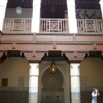 Typical architecture of Moroccan townhouses with an internal court. Notice the fine mosaics and the wonderful woodwork.