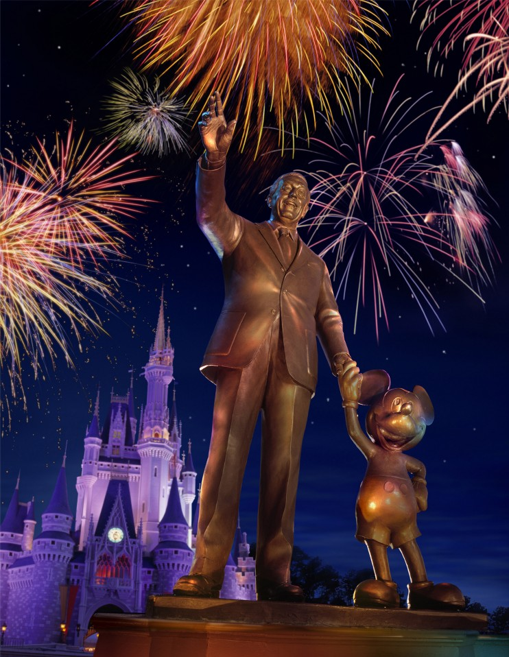 Partners statue with fireworks