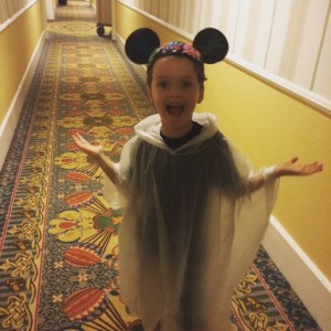 My son enjoying the rain while at Walt Disney World