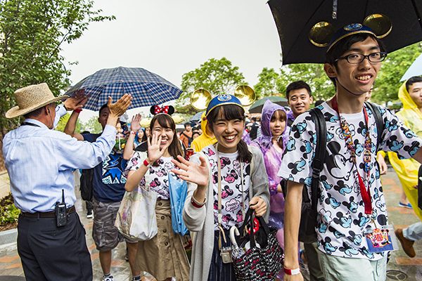 Shanghai Disneyland Grand Opening Guests waving