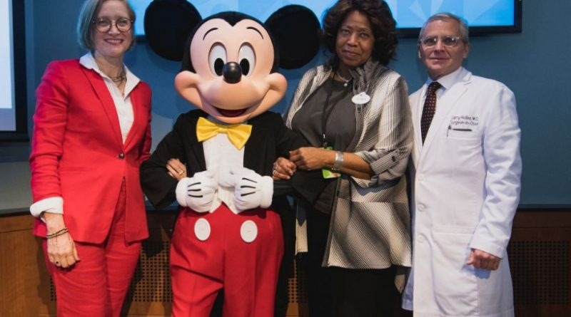 "Disney Team of Heroes Debuts Innovative Experiences at Texas Children's Hospital Just over 12 months since Bob Iger, Chairman and CEO of The Walt Disney Company, announced a bold $100 million commitment to support children's hospitals around the world, leaders from Disney and Texas Children's Hospital in Houston, Texas, debuted a suite of experiences, murals and interactive art aimed at providing comfort and inspiration for children and families. The initiative, called Disney Team of Heroes, builds on The Walt Disney Company's long legacy of delivering comfort and inspiration to families with children facing serious illness. Disney Team of Heroes combines Disney's beloved characters with the unparalleled creativity of its employees and cast members to bring classic stories to life in innovative ways that are designed to reduce the anxiety of a hospital stay. ""As the name 'Team of Heroes' implies, at Disney we know that if you want something to be timeless and touch the hearts of millions, it requires a talented team to bring it all to life. That is why we are so fortunate to have Texas Children's Hospital and our advisory board help guide on this effort,"" said Elissa Margolis, senior vice president, Enterprise Social Responsibility. ""We could not have done this without all the guidance, partnership and collaboration from doctors, nurses, hospital administrators, child life specialists, creative teams, tech leaders and also, importantly, parents."" To reimagine the patient journey, Disney consulted a Panel of Experts that included physicians, caregivers and child life specialists who stated that the Company could make the greatest impact by focusing on moments of highest anxiety for children and families in hospitals, such as arrival and transitions to examination and operating rooms (including the ""kissing zone,"" in which patients and their families separate before the child undergoes surgery). Teams from every line of business across The Walt Disney Company came together to deliver solutions that are simple for hospitals to implement, sustain and scale. The concepts unveiled at Texas Children's Hospital (TCH) today are designed by many of Disney's creative and technology experts, storytelling and experience experts, and the world-renowned Imagineers, who set out to bring a little bit of Disney magic to families during a challenging and uncertain time. The teams at Disney took a holistic approach to the program, which encompasses a range of experiences, from reimagined public spaces that create a warm and inspiring atmosphere for patients and families; to personal moments that empower patients and build connections to caregivers and hospital staff; and engaging content that will be accessed across a variety of platforms and transformative events. They also focused on opportunities to engage hospital staff, who are an integral part of these magic moments Disney has created for patients and their families. In TCH's public spaces, Imagineers today unveiled Magic Windows, which provide mesmerizing views into the active, living worlds found in the stories of Disney, Pixar, Marvel and Star Wars; and Magic Portals, which engage patients and families with games and favorite characters from across the worlds of Disney. Breathtaking murals, intended to draw one's imagination into the vibrant environments of Disney's classic stories, have been designed with a magical twist: The characters from each mural spark to life in stories and games that can be accessed via the Disney WOW app on mobile devices. The Disney WOW app activates augmented reality experiences that help create a more personal journey for each patient—one of the program's key objectives. A child can literally wear their favorite character, thanks to themed hospital gowns that feature costume style designs from Disney, Marvel and Star Wars. Newly designed wristbands, which debut today, help staff recognize the favorite character of a child and also serve as symbolic ""tickets"" to special experiences and spaces throughout the hospital. Patients select their wristband and their chosen character remains with them throughout their hospital journey via personal experiences that include care packages, and the delightfully charming Magic Art, which delivers fun, animated, inspirational messages to patients. An array of colorful Disney-themed products featuring characters patients know and love are intended to make hospital rooms feel more like home and a patient's stay more comfortable. Care packages come filled with toys, games, books and activities that entertain patients; while an array of themed room décor items—from tray liners to cups—also helps to bring color and familiarity to the patient's room and brighten his or her stay. Engaging content and events will provide welcome distractions for patients and create opportunities to spend time with family and friends. In addition to the Disney WOW app, patients can access stories, games and other entertainment offerings through the DisneyNOW app on mobile devices and enjoy them throughout the hospital or from the comfort of their room. A virtual reality headset, designed in partnership with Starlight Children's Foundation specifically for children's hospitals, immerses patients in a new realm of fantastic experiences—filled with beloved characters and delightful story worlds—that they can explore from their own hospital beds, and a Mobile Movie Theater makes it possible for patients to view favorite movies with family and friends in various gathering spaces throughout the hospital. Disney has also created opportunities for hospital staff to connect with the program while forging deeper connections with their patients. Themed Staff Badges—each representing a favorite Disney character of the staff member who wears it—activate special and engaging moments for patients and family to enjoy throughout the hospital. Additionally, hospital leaders and staff will receive specialized training provided by Disney Institute to help them deliver an exceptional level of care, compassion, comfort and connection—along with a little Disney magic. The TCH pilot will enable the Disney teams to learn more, adapt and continue to strengthen the initiative overall for the benefit of patients, families and hospital staff. Additional concepts will be added over time, including a Comfort Corridor, which incorporates artwork and music to provide comfort and distraction for patients and families prior to surgery; and one-of-a-kind, story-themed Playspaces where anyone can play, interact and make new friends. As the program rolls out in additional hospitals here in the U.S. and around the globe, teams at Disney will continue to collaborate with experts to measure the impact of the work and ensure the Company is delivering on its commitment to ease the stress of a hospital stay in ways only Disney can. ""The magic and joy we have all experienced at a Disney park is now apparent as you walk throughout our hospital, and I am looking forward to seeing how this special partnership enhances the patient and family experience at Texas Children's,"" said Dr. Larry Hollier, surgeon-in-chief, Texas Children's Hospital."