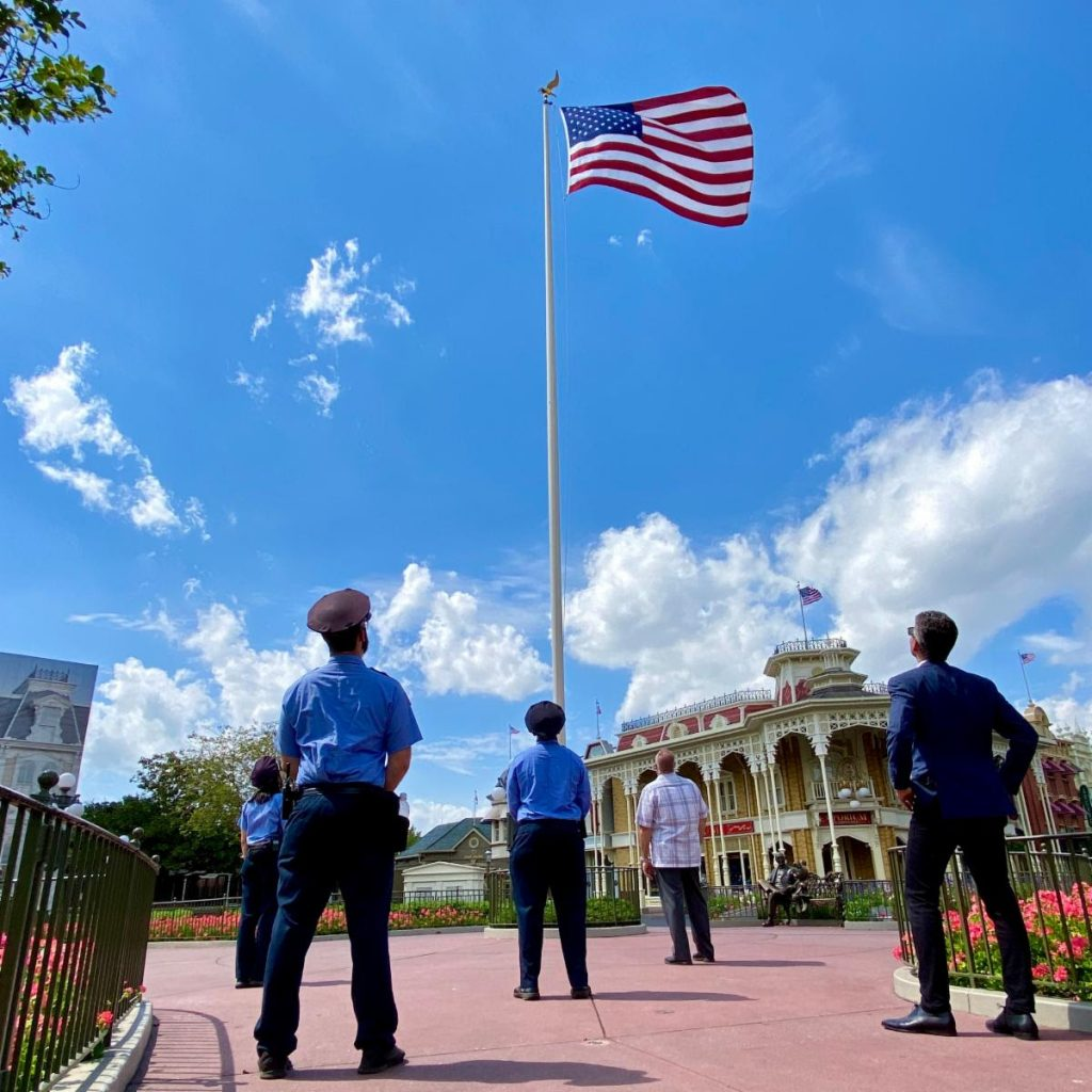 Josh D'Amaro security guards, flag, magic kingdom, Main Street